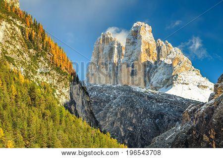 Amazing autumn alpine landscape Tre Cime Di Lavaredo snowy peaks in background Dolomites Italy Europe