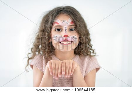 Portrait of a cute little girl with face painted