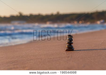 Pyramid of the small pebbles on the beach. Stones