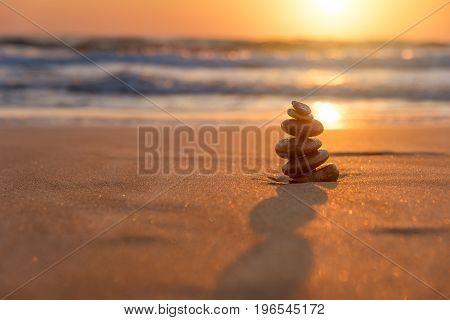 Stones Balance in sunrise at sea in april
