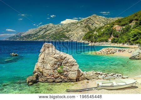 Typical mediterranean beaches and fishing motorboat Makarska riviera Brela Dalmatia Croatia Europe