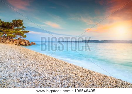 Amazing colorful sunset over the beach near Brela Makarska riviera Dalmatia Croatia Europe