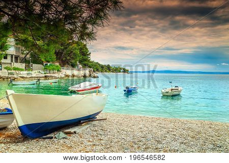 Amazing harbor with fishing boats Adriatic Sea and majestic bay on Brela resort Makarska riviera Dalmatia Croatia Europe