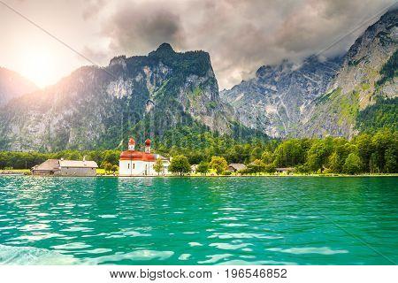 Amazing fabulous alpine glacier lake Konigsee with stunning St Bartholoma church Berchtesgaden Bavaria Germany Europe