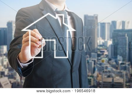 Professional Business Man Drawing Digital House Icon With City View Background For Residential Devel