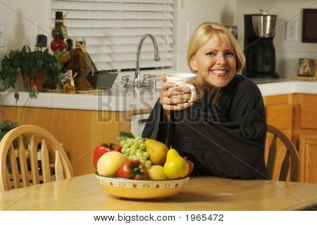 Beautiful, Young, Successful Woman Enjoying A Cup Of Coffee In Her Home.