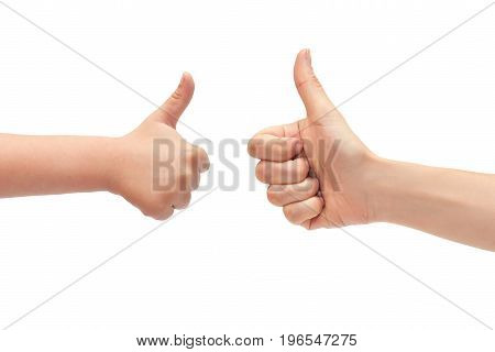 Hand Of Young Girl And Kids Hand Gesture, Shows Thumbs Up. Isolated On White Background