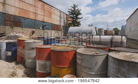 On the closed territory there are barrels with spent oil products