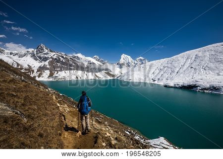 Man is trekking near Gokyo lake in Everest region Nepal