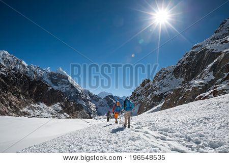 Trekkers crossing Cho La pass in Everest region Nepal