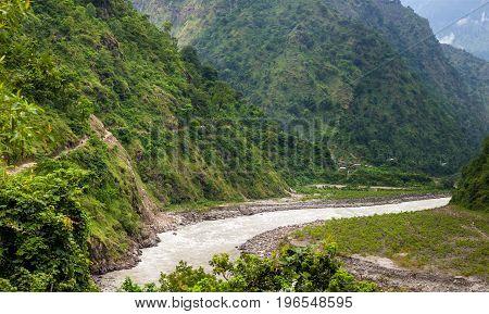 Green valley in Himalaya mountains along Manaslu circuit track in Nepal