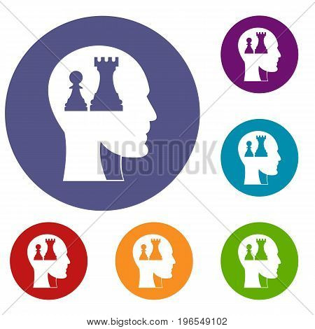 Head with queen and pawn chess icons set in flat circle red, blue and green color for web