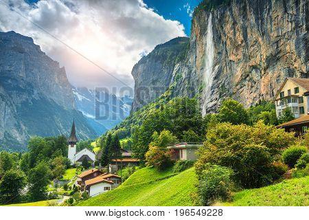 Amazing touristic alpine village with famous church and Staubbach waterfall Lauterbrunnen Switzerland Europe