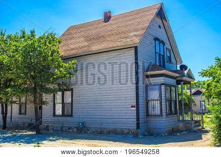 Abandoned Two Story Home With No Trespassing Sign