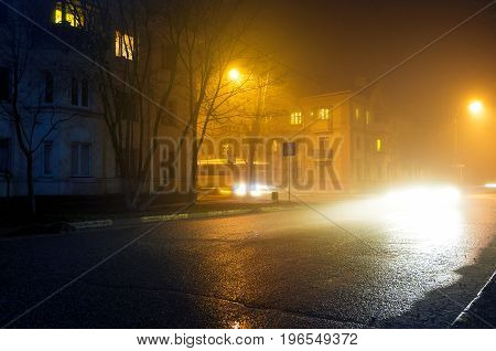 Night street city road lights cars in small town europe