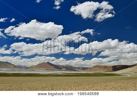 View of Tso Kar Lake in the Karakorum Mountains near Leh India. This lake is a frequent destination for tourists.