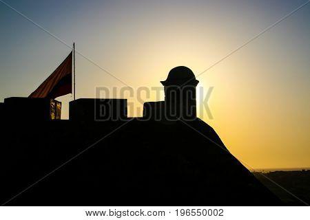 Silhouette of the San Felipe Castle in Cartagena de Indias at sunset