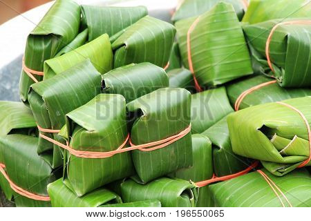 Sour pork wrapped in banana leaves delicious