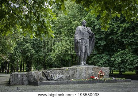 Minsk Belarus -July 7: Monument to Belarusian poet Yanka Kupala is removed after laying flowers in honor of the classic's 135th birthday on July 7 2017