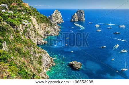 Amazing Faraglioni cliffs panorama with the majestic Tyrrhenian sea in background Capri island Campania region Italy Europe