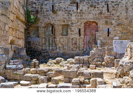 ancient ruins of old stone fortress and wall