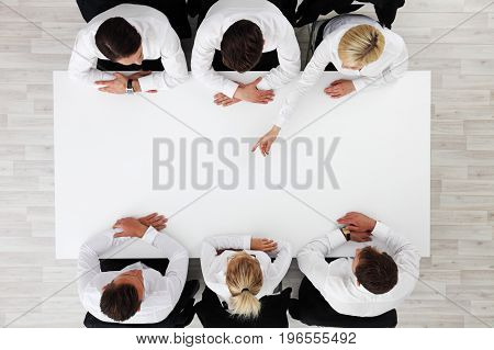 Business People Sitting Around Empty Table