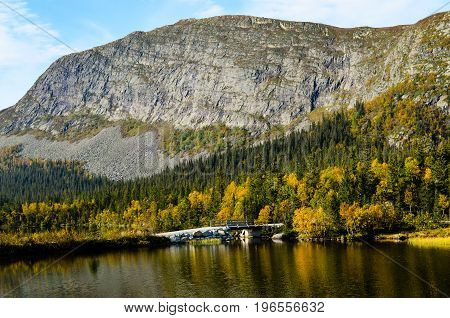 massive rocks at fjord landscape in norway during sunny autumn day