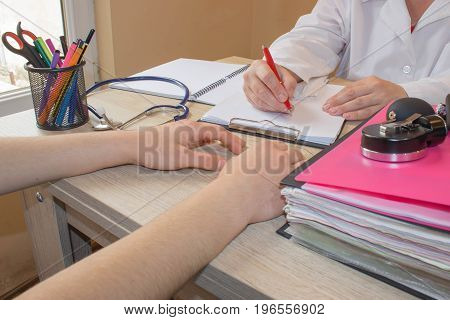 Female doctor and patient Writing application form while consulting patient. Medical and Health care concept