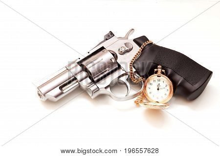 Beautiful revolver and a pocket watch lies on a white background