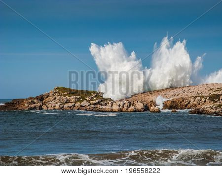 Big wave over the rocks in Cantabria Spain