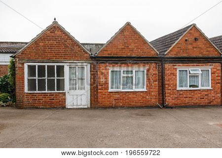 Leicestershire, United Kingdom - March 28, 2017: Traditional English Red Bricks Small Garten Buildin