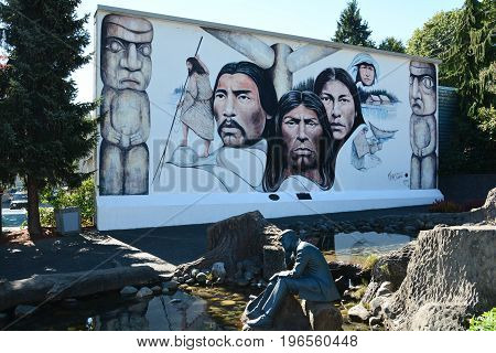 Chemainus BC,Canada,August 29th 2016.A wall mural depicting First Nation people,  culture and ways of life.Native leaders and elders and totems high lite the mural in Chemainus BC.Come to Chemainus and enjoy BC.
