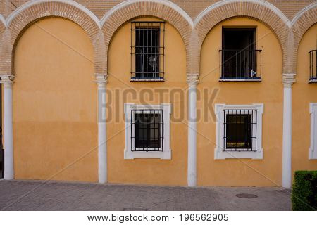 Yellow Arches Above The Balcony Window In Seville, Spain, Europe