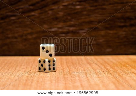 Dice on a wooden background objects for popular various board games are small plastic cubes with numbers