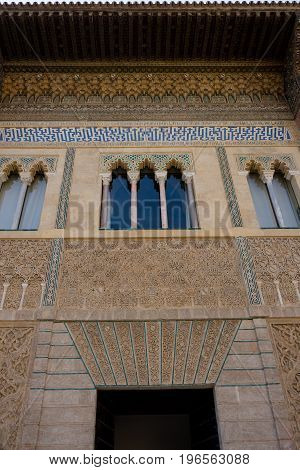 Stylised windows in Alcazar palace, Seville Spain Europe