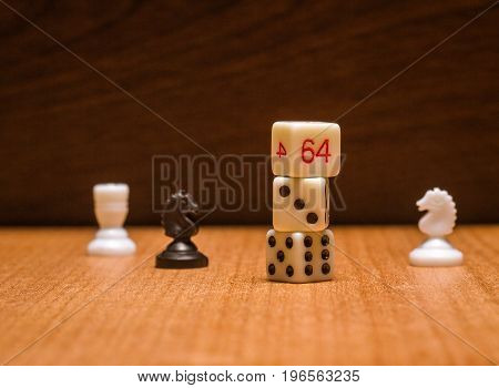 Dices of a horse and a rooks on a wooden background are objects for the world's most popular board games that develop logical thinking