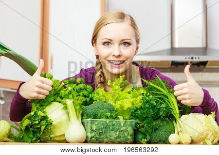 Woman In Kitchen With Green Vegetables