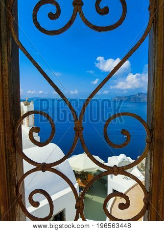 View to the sea from doors in Oia the most beautiful village of Santorini island in Greece