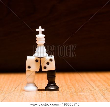 Chess king dice and two rooks on a wooden background objects for developing logic and thinking board games