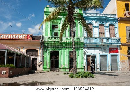 Havana, Cuba - June 30, 2016; Neo-classical style architecture in neglected state and bright colors in Caribbean island Cuba.
