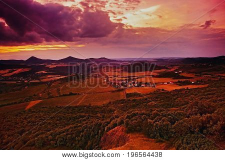 Sunset View From Radobyl Hill To Michalovice Village And Milesovka Hill On Horizont In Chko Ceske St