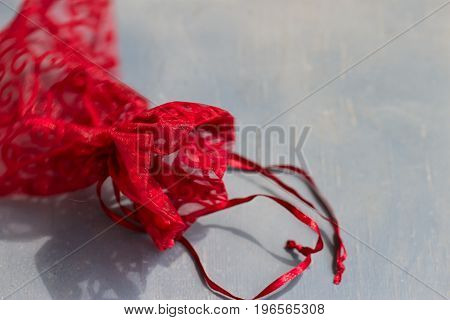 Red drawstring bag On a gray-blue background