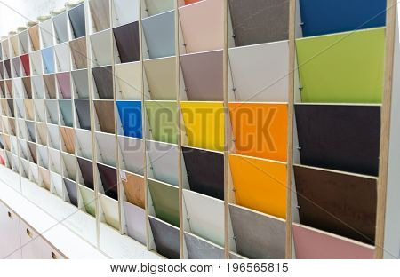 Colored samples of wooden tiles standing in a row