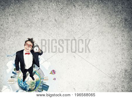 Funny disheveled businessman with alarm clock from top view. Elements of this image are furnished by NASA