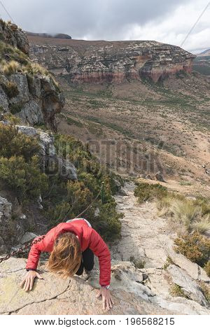 Tourist Climbing Cliff In The Golden Gate Highlands National Park, South Africa. Adventure And Explo