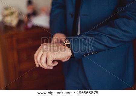 The Man Fastens The Watch On His Hand
