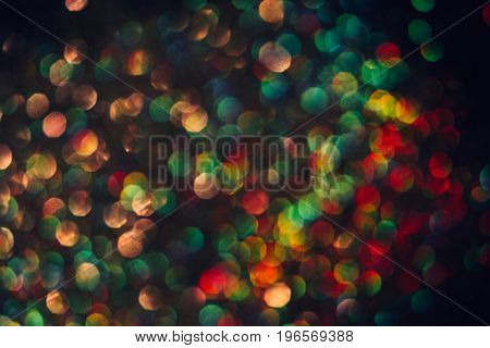 Abstract blurred glittering shine background, colorful halo. Blur light bokeh. Christmas wallpaper decorations concept. New year holiday festive backdrop. Sparkle circle celebrations display.