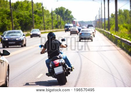 Soft focus. Biker in the traffic on the road