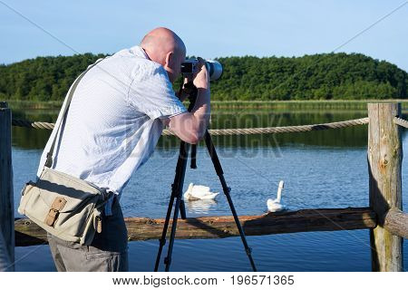 Photographer on a lake in the Mueritz National Park in Germany