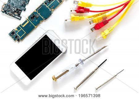 Repairing gadgets. Parts and tools on white background top view.